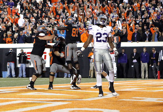 Kansas State's Emmanuel Lamur (23) reacts as Oklahoma State's Nick Martinez (75), Grant Garner (74) and Justin Blackmon (81) celebrate a touchdown late in the fourth quarter during a college football game between the Oklahoma State University Cowboys (OSU) and the Kansas State University Wildcats (KSU) at Boone Pickens Stadium in Stillwater, Okla., Saturday, Nov. 5, 2011.  Photo by Sarah Phipps, The Oklahoman