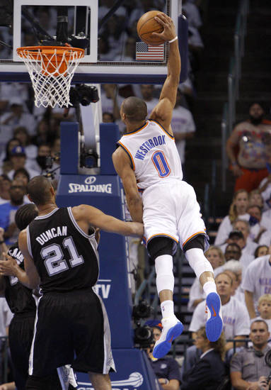 Oklahoma City's Russell Westbrook (0) goes up for a dunk next to San Antonio's Tim Duncan (21) during Game 6 of the Western Conference Finals between the Oklahoma City Thunder and the San Antonio Spurs in the NBA playoffs at the Chesapeake Energy Arena in Oklahoma City, Wednesday, June 6, 2012. Photo by Bryan Terry, The Oklahoman