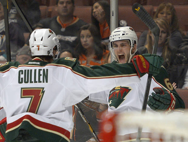 Minnesota Wild defenseman Marco Scandella, right, celebrates his goal with center Matt Cullen during the first period of an NHL hockey game against the Anaheim Ducks, Friday, Feb. 1, 2013, in Anaheim, Calif. (AP Photo/Mark J. Terrill)