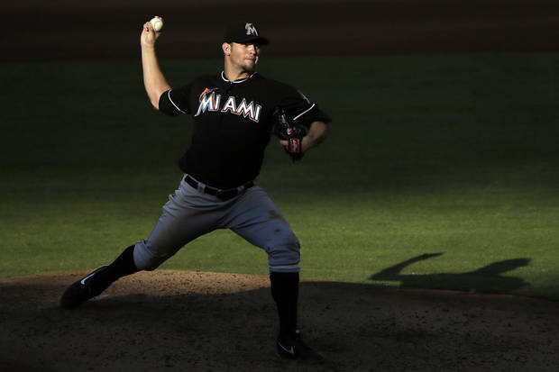 FILE - In this Sept. 12, 2012, file photo, Miami Marlins' Josh Johnson pitches in the fourth inning of a baseball game against the Philadelphia Phillies in Philadelphia. A person familiar with the deal told The Associated Press on condition of anonymity Tuesday, Nov. 13, that the Marlins have traded Johnson to the Toronto Blue Jays. (AP Photo/Matt Slocum, File)