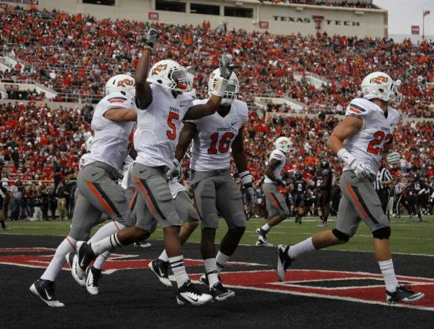 Oklahoma State's Josh Stewart (5) celebrates a Cowboys fumble recovery on a kick off during a NCCA football game between Texas Tech University (TTU) and Oklahoma State University (OSU) at Jones AT&T Stadium in Lubbock, Texas, Saturday, Nov. 12, 2011. Photo by Sarah Phipps, The Oklahoman <strong>SARAH PHIPPS</strong>