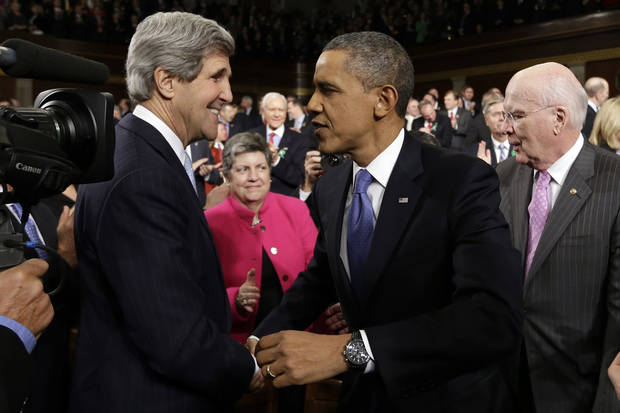Secretary of State John Kerry greets President Barack Obama before the president's State of the Union address during a joint session of Congress on Capitol Hill in Washington, Tuesday Feb. 12, 2013. Sen.Patrick Leahy, D-Vt. is at right, Homeland Security Secretary Janet Napolitano is at center. (AP Photo/Charles Dharapak, Pool) ORG XMIT: CAP511