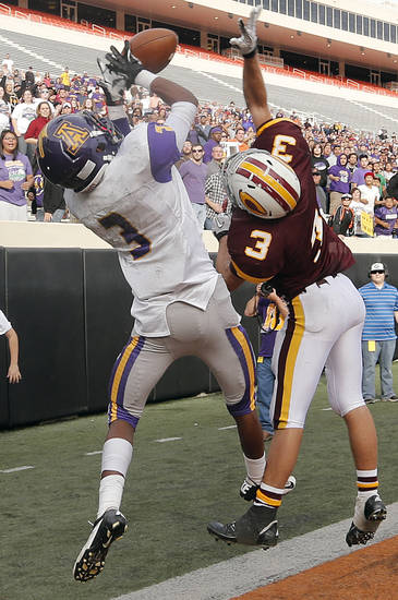 Clinton's Bowman Vowell (3) breaks up a pass in the end zone for Anadarko's Josh Parton (3) in the final seconds of  the Class 4A Oklahoma state championship football game between Anadarko and Clinton at Boone Pickens Stadium on Saturday, Dec. 1, 2012, in Stillwater, Okla.   Photo by Chris Landsberger, The Oklahoman