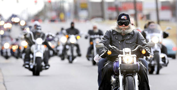 About 300 motorcycle riders participated in a recent charity ride in southwest Oklahoma City to gather Christmas toys for needy children. <strong>Jim Beckel - THE OKLAHOMAN</strong>
