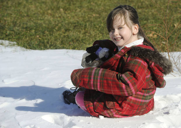 "In this Feb. 10, 2013 photo, Kelly Guarna's 5-year-old daughter Madison pose for a portrait in Mount Carmel, Pa. The kindergartener was suspended from school for making a ""terroristic threat"" last month after her mother said she talked about shooting a Hello Kitty bubble gun. (AP Photo/Jimmy May)"