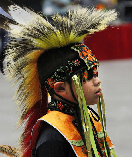 Phillip Tsonetokoy, 7, of Anadarko, waits to participate in one of the dances for children at the 2012 Red Earth Festival  inside the Cox Convention center on Saturday, June 9,  2012. He is a member of Kiowa/Quapah tribes.    Photo by Jim Beckel, The Oklahoman