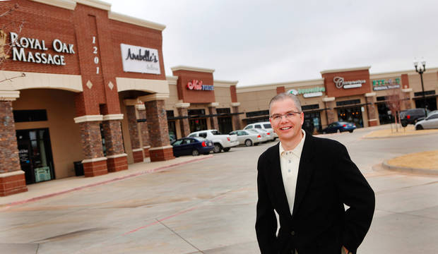 Stuart Graham,  retail broker,  on the grounds of Highland Park Shopping Center, NW 178 and Western on Thursday,  Dec. 22, 2011. Photo by Jim Beckel, The Oklahoman