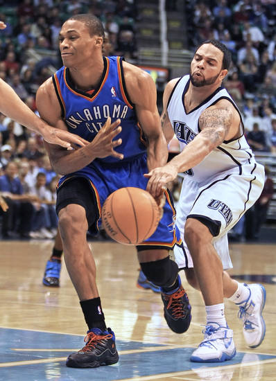 The Thunder's Russell Westbrook, left, has the ball knocked away by Utah's Deron Williams. AP photo