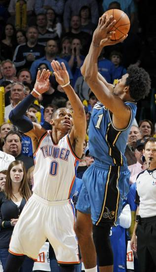 Nick Young (1) of Washington shoots over Russell Westbrook (0) of Oklahoma City during the NBA basketball game between the Washington Wizards and the Oklahoma City Thunder at the Oklahoma City Arena in Oklahoma City, Friday, January 28, 2011. The Thunder won, 124-117, in double overtime. Photo by Nate Billings, The Oklahoman
