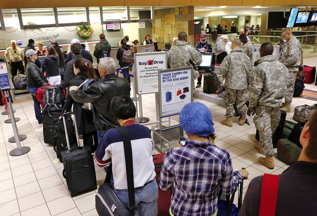 Lines form early Thursday,  Dec. 20, 2012,  at an American Airlines counter inside Will Rogers World Airport  as holiday travelers check in for morning flights.  Photo by Jim Beckel, The Oklahoman