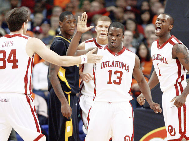 "OU's Willie Warren, center, celebrates with Cade Davis (left), Blake Griffin (back) and Ryan Wright during the Sooners' win over VCU on Dec. 20. One of the reasons Warren came to OU was to have the opportunity to play with Griffin. Griffin's presence is having a trickle-down effect on the program, which could bring in a pair of McDonald's All-Americans in Tommy Mason-Griffin and Keith ""Tiny"" Gallon. PHOTO BY BRYAN TERRY, THE OKLAHOMAN"