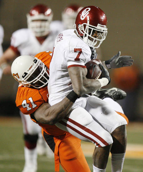 OSU's Orie Lemon slams OU's DeMarco Murray to the turf during the second half of the college football game between the University of Oklahoma Sooners (OU) and Oklahoma State University Cowboys (OSU) at Boone Pickens Stadium on Saturday, Nov. 29, 2008, in Stillwater, Okla. STAFF PHOTO BY SARAH PHIPPS