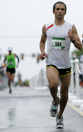 Mindaugas Pukstas runs toward the finish line as he wins the 11th Annual Oklahoma City Memorial Marathon in Oklahoma City on Sunday, May 1, 2011. Photo by John Clanton, The Oklahoman