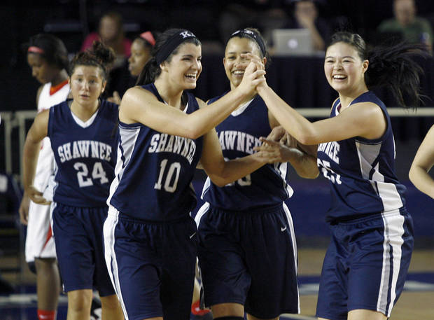 CLASS 5A GIRLS HIGH SCHOOL BASKETBALL: Shawnee's Taylor Cooper (foreground left) and Micaela Yu (right) high five as they walk off the court with teammates Kelsee Grovey (center) and Bailey Taylor (background left) after their win over Carl Albert during a basketball game at Oral Roberts University in Tulsa on Friday, March 9, 2012. MATT BARNARD/Tulsa World