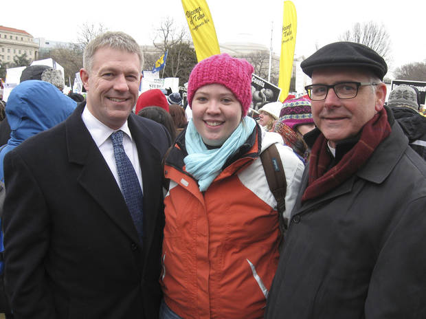 Oklahoma City attorney Kevin Calvey, left, Abby Pollart, of Lawton, and Oklahoma City Archbishop Paul Coakley pause Friday during the anti-abortion march in Washington. Photo by  Chris Casteel, The Oklahoman