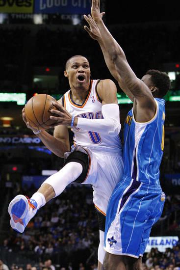 Oklahoma City Thunder guard Russell Westbrook, left, goes to the basket as New Orleans Hornets forward Al-Faroug Aminu, right, defends during the first quarter of an NBA basketball game in Oklahoma City, Wednesday, Feb. 27, 2013. (AP Photo/Alonzo Adams)