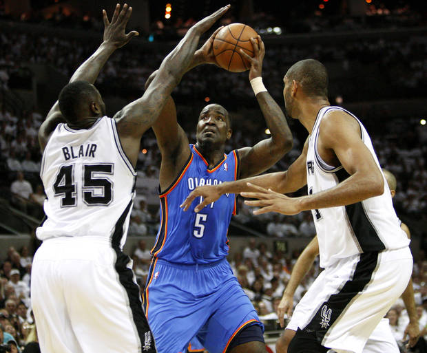Oklahoma City's Kendrick Perkins (5) shoots the ball between San Antonio's DeJuan Blair (45) and Tim Duncan (21) during Game 5 of the Western Conference Finals between the Oklahoma City Thunder and the San Antonio Spurs in the NBA basketball playoffs at the AT&T Center in San Antonio, Monday, June 4, 2012. Photo by Nate Billings, The Oklahoman