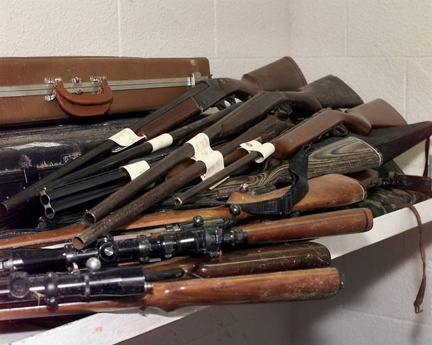 Guns, found in tornado aftermath, are kept in a jail cell in the Del City police department.
