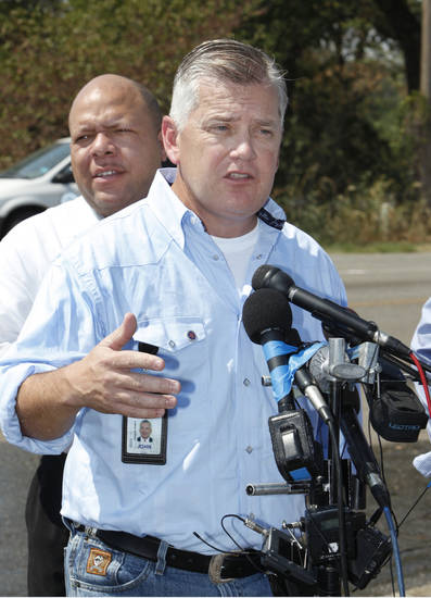 FIRES: State Insurance Commissioner John Doak addresses the media at the NE 63 Street and Sooner Road command post about recent wildfires in Oklahoma City Thursday, Sept. 1, 2011.  In the background is Rep. Mike Shelton, D-Oklahoma City. Photo by Paul B. Southerland, The Oklahoman ORG XMIT: KOD