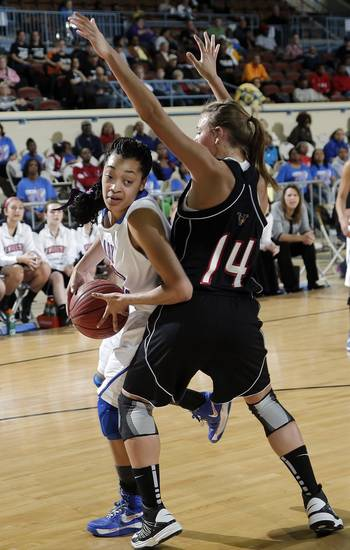 Millwood's Mekale Chapple (20) tries to get by Verdigris' Courtney Risenhoover (14) during the 3A girls quarterfinals game between Millwood High School and Verdigris High School at the State Fair Arena on Thursday, March 7, 2013, in Oklahoma City, Okla. Photo by Chris Landsberger, The Oklahoman