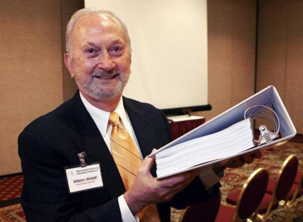"Devon Energy Corp. executive William Whitsitt holds up a copy of the ""Cap and Trade"" bill during an annual meeting of Mid-Continent Oil and Gas Association of Oklahoma at the Marriott Hotel in Oklahoma City, OK, Thursday, Nov. 12, 2009. By Paul Hellstern, The Oklahoman ORG XMIT: KOD"