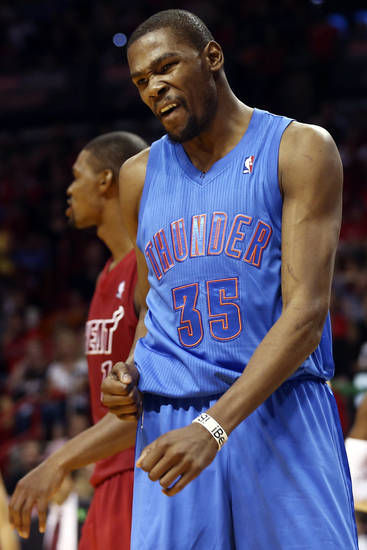 Oklahoma City Thunder's Kevin Durant (35) reacts after being charged with a foul against the Miami Heat during the second half of an NBA basketball game in Miami, Tuesday, Dec. 25, 2012. The Heat won 103-97. (AP Photo/J Pat Carter) ORG XMIT: FLJC112