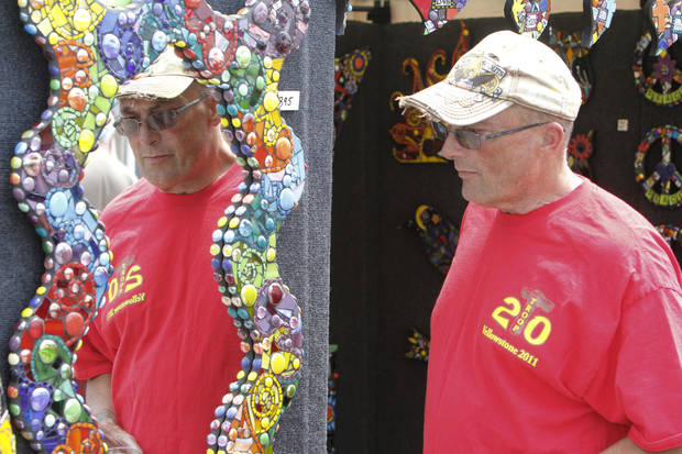 Tom Garrett looks at a colorful mirror during the Paseo Arts Festival in Oklahoma City, OK, Saturday, May 26, 2012,  By Paul Hellstern, The Oklahoman