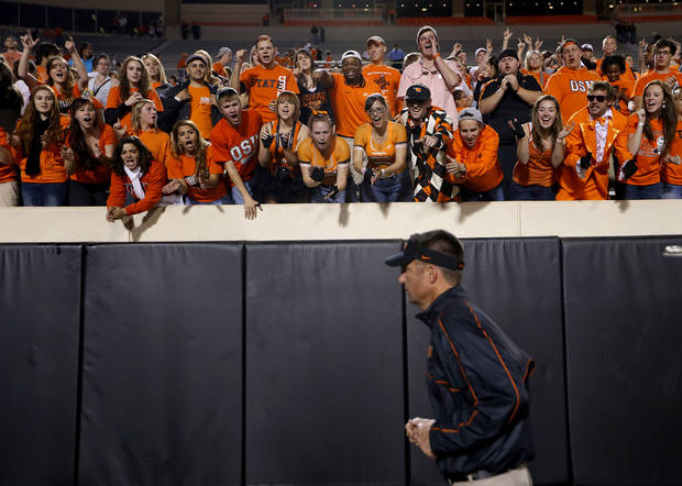 Fan cheer on Oklahoma State head coach Mike Gundy during a college football game between Oklahoma State University (OSU) and the West Virginia University at Boone Pickens Stadium in Stillwater, Okla., Saturday, Nov. 10, 2012. Photo by Sarah Phipps, The Oklahoman