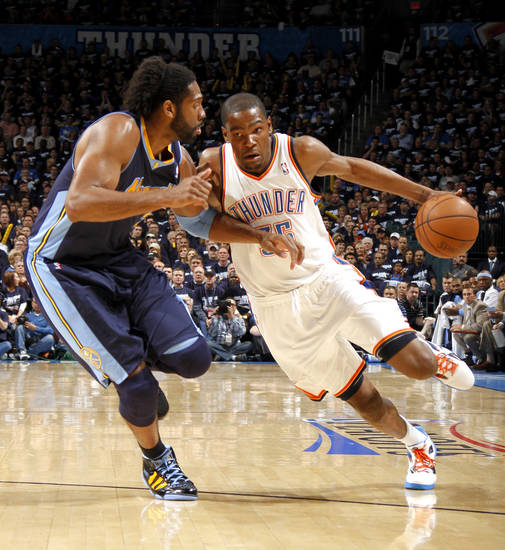 Oklahoma City's Kevin Durant (35) drives past Denver's Nene (31) during the NBA basketball game between the Denver Nuggets and the Oklahoma City Thunder in the first round of the NBA playoffs at the Oklahoma City Arena, Wednesday, April 27, 2011. Photo by Bryan Terry, The Oklahoman