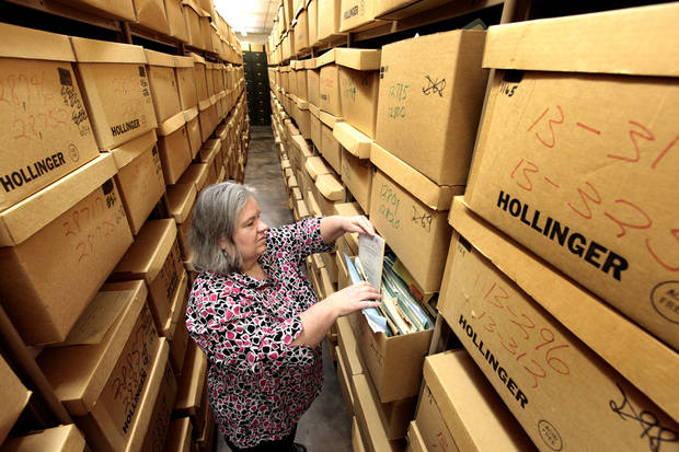 Archivist Jan Davis looks through papers from the 1960 Court of Criminal Appeals at the Oklahoma State Archives on the top floor of the Department of Libraries. Photo By David McDaniel, The Oklahoman