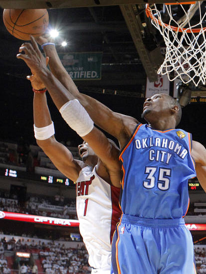 Oklahoma City's Kevin Durant (35) goes for the ball beside Miami's Chris Bosh (1) during Game 3 of the NBA Finals between the Oklahoma City Thunder and the Miami Heat at American Airlines Arena, Sunday, June 17, 2012. Photo by Bryan Terry, The Oklahoman
