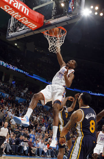 Oklahoma City&#039;s Kevin Durant dunks the ball in front of Deron Williams during the NBA basketball game between the Oklahoma City Thunder and Utah Jazz in the Oklahoma City Arena on Sunday, Oct. 31, 2010. Photo by Sarah Phipps, The Oklahoman