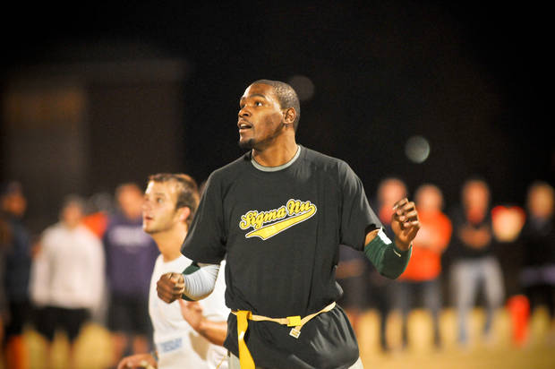 Kevin Durant plays in an intramural flag football game with Sigma Nu fraternity at Oklahoma State University, Oct. 31, 2011. Photo by KT King, with permission. (@shuttrking)