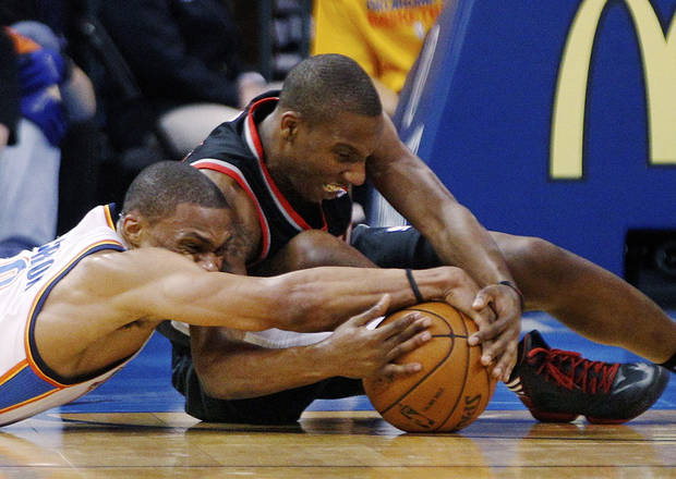Oklahoma City Thunder guard Russell Westbrook, left, and Portland Trail Blazers guard Nolan Smith scramble for the ball in the first quarter of an NBA basketball game in Oklahoma City, Friday, Nov. 2, 2012. (AP Photo/Sue Ogrocki)