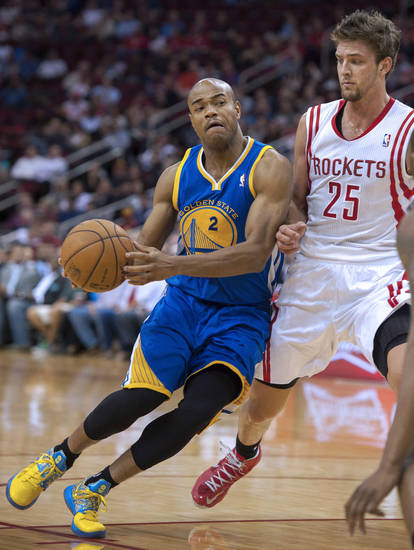 Golden State Warriors' Jarrett Jack (2) drives around Houston Rockets' Chandler Parsons (25) during the first quarter of an NBA basketball game, Tuesday, Feb. 5, 2013, in Houston. (AP Photo/Dave Einsel)
