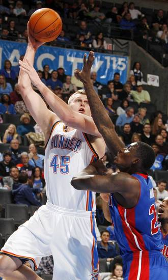 Oklahoma City's Cole Aldrich (45) shoots over Vernon Macklin (20) of Detroit during the NBA basketball game between the Detroit Pistons and Oklahoma City Thunder at the Chesapeake Energy Arena in Oklahoma City, Monday, Jan. 23, 2012. Oklahoma City won, 99-79. Photo by Nate Billings, The Oklahoman