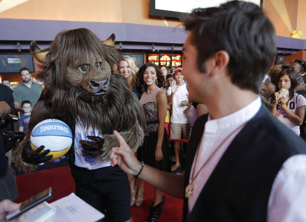 Rumble The Bison greets actor Taylor Gray during the red carpet premiere of Thunderstruck at Harkins Bricktown Theatre in Oklahoma City, Sunday, Aug. 19, 2012.  Photo by Garett Fisbeck, For The Oklahoman