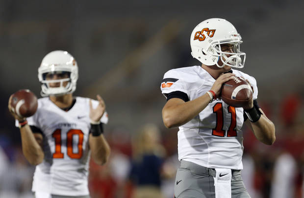 Oklahoma State's Wes Lunt (11) and Clint Chelf (10) warm up before the college football game between the University  of Arizona and Oklahoma State University at Arizona Stadium in Tucson, Ariz.,  Saturday, Sept. 8, 2012. Photo by Sarah Phipps, The Oklahoman