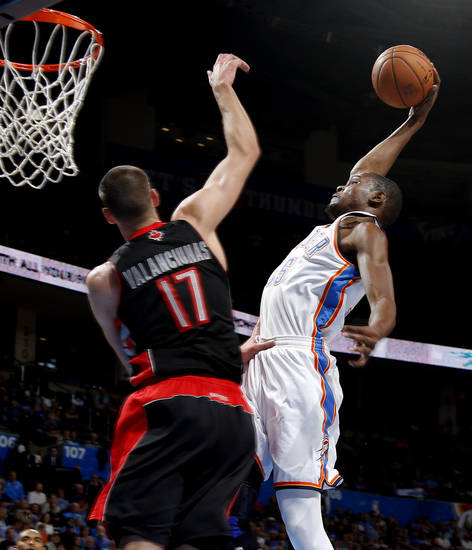 Oklahoma City's Kevin Durant (35) dunks the ball beside Toronto's Jonas Valanciunas (17) during an NBA basketball game between the Oklahoma City Thunder and the Toronto Raptors at Chesapeake Energy Arena in Oklahoma City, Tuesday, Nov. 6, 2012.  Tuesday, Nov. 6, 2012. Photo by Bryan Terry, The Oklahoman