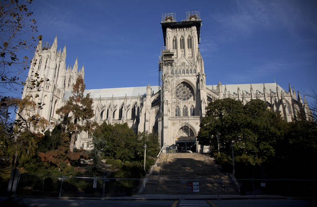 FILE - Scaffolding is seen on the Washington National Cathedral in this Nov. 12, 2011 file photo taken before the consecration service of the first female Bishop of Washington, Rev. Mariann Edgar Budde. The Washington National Cathedral, where the nation gathers to mourn tragedies and celebrate new presidents, will soon begin performing same-sex marriages. It will announce its new policy Wednesday Jan. 9, 2013. (AP Photo/Carolyn Kaster, File)