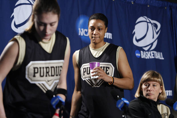 Purdue player Lindsay Wisdom-Hylton enters the interview area to speak to the media before their elite eight appearance in NCAA women's basketball tournament at the Ford Center in Oklahoma City, Okla. on Monday, March 30, 2009. 