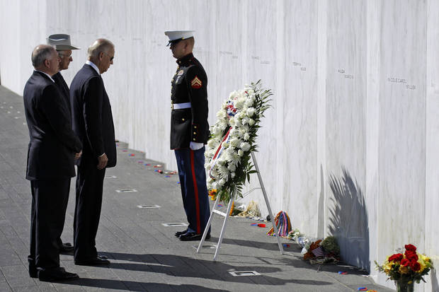 Vice President Joe Biden, third from left, Interior Secretary Ken Salazar, second from left, and President of the Families of Flight 93, Patrick G. White, left, pauses after laying a wreath at The Wall of Names at the Flight 93 National Memorial in Shanksville, Pa., Tuesday, Sept. 11, 2012. (AP Photo/Gene J. Puskar)