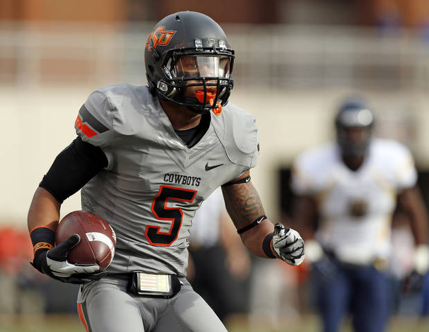 Oklahoma State's Josh Stewart (5) carries the ball on a reverse for a touchdown in the first quarter during a college football game between Oklahoma State University (OSU) and West Virginia University (WVU) at Boone Pickens Stadium in Stillwater, Okla., Saturday, Nov. 10, 2012. Photo by Nate Billings, The Oklahoman