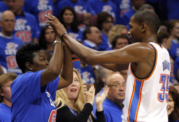 Oklahoma City's Kevin Durant high fives his mom Wanda Pratt during Game 5 in the second round of the NBA playoffs between the Oklahoma City Thunder and the L.A. Lakers at Chesapeake Energy Arena in May 2012 in Oklahoma City.  <strong>SARAH PHIPPS - SARAH PHIPPS</strong>