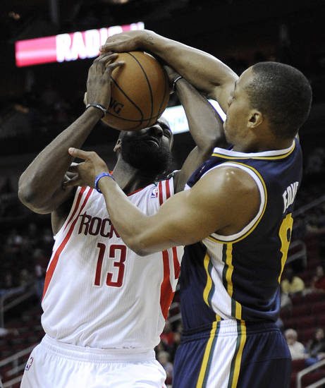 Utah Jazz's Randy Foye (8) tries to grab the ball from Houston Rockets' James Harden (13) in the first half of an NBA basketball game on Saturday, Dec. 1, 2012, in Houston. (AP Photo/Pat Sullivan)