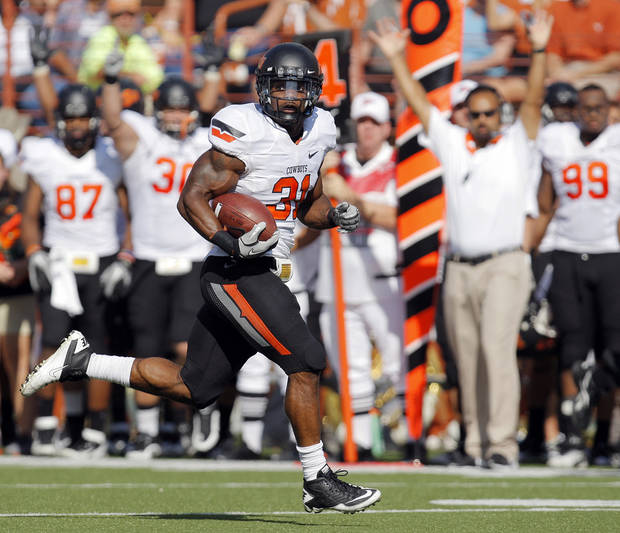 Oklahoma State's Jeremy Smith (31) rushes for a touchdown in the second quarter during a college football game between the Oklahoma State University Cowboys (OSU) and the University of Texas Longhorns (UT) at Darrell K Royal-Texas Memorial Stadium in Austin, Texas, Saturday, Oct. 15, 2011. Photo by Nate Billings, The Oklahoman
