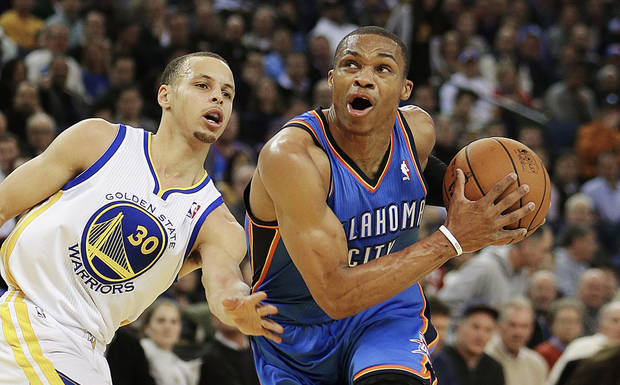 Oklahoma City Thunder&#039;s Russell Westbrook, right, drives past Golden State Warriors&#039; Stephen Curry (30) during the first half of an NBA basketball game, Wednesday, Jan. 23, 2013, in Oakland, Calif. (AP Photo/Ben Margot)