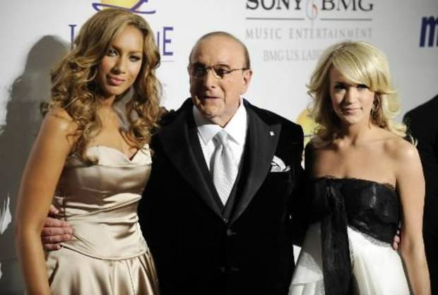 (from left) Leona Lewis, Clive Davis and Carrie Underwood attended a Grammy party in 2008 (AP Photo by Chris Pizzello)
