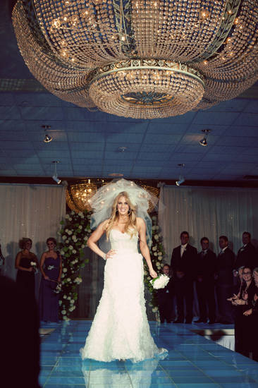 Malorie Gulikers walks the lighted runway at her wedding. Photo by Traina Photography. <strong></strong>