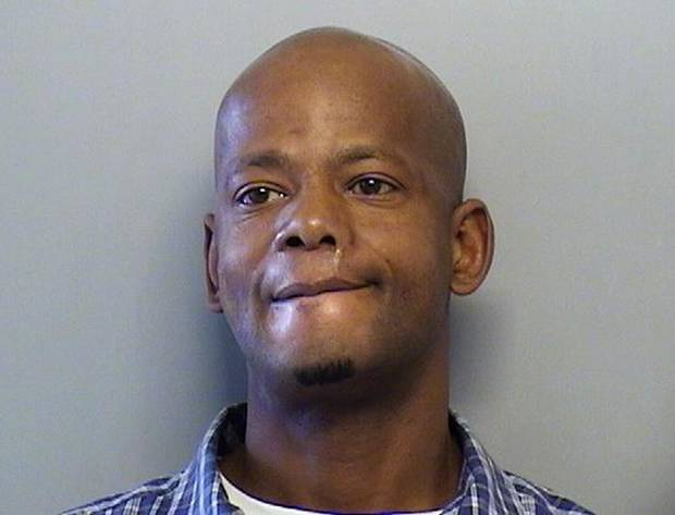 This handout booking photo provided by the Tulsa County Sheriff's Office shows Cedric Poore. Tulsa police say they have arrested Cedric Poore and his brother James Poore for the Jan. 7, 2013, shooting death of four women in a Tulsa, Okla. apartment. (AP Photo/Tulsa County Sheriff's Office)